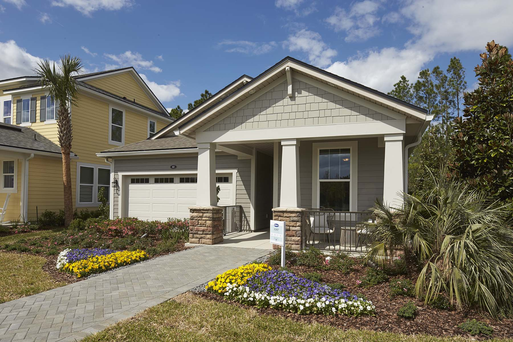 Egret Plan Front Porch at RiverTown - Arbors in St. Johns Florida by Mattamy Homes
