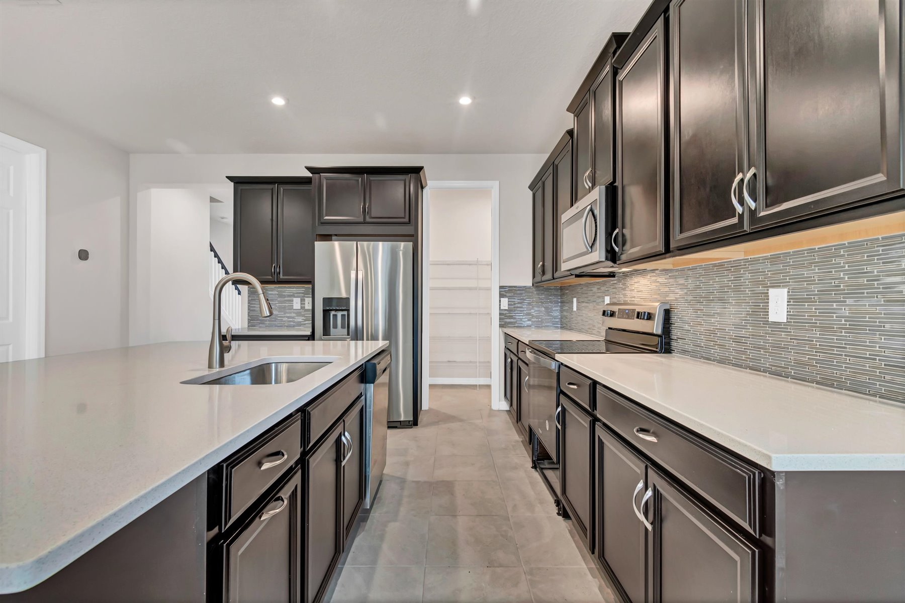 Dominica Plan Kitchen at Tapestry in Kissimmee Florida by Mattamy Homes