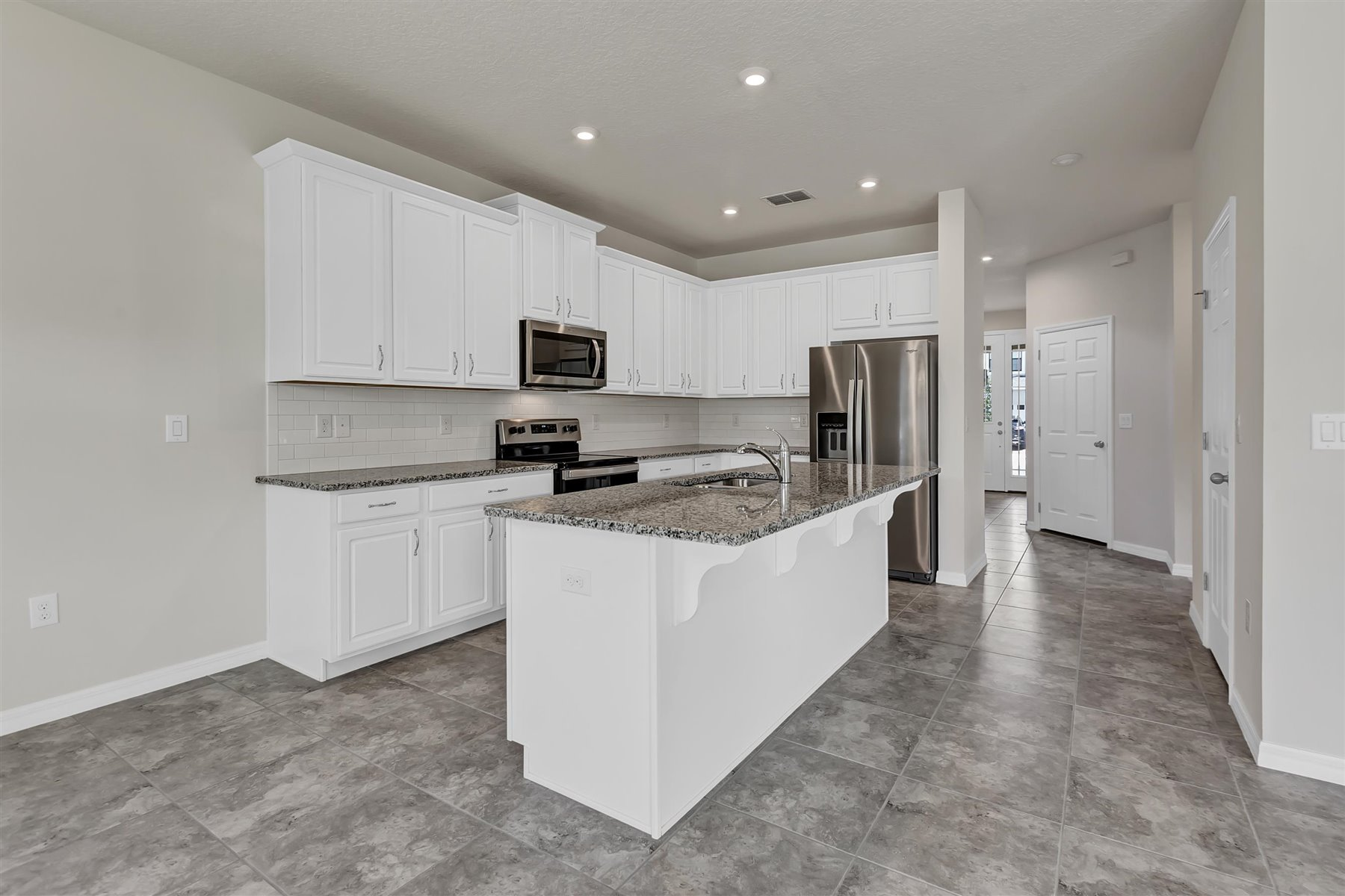Palmetto Plan Kitchen at Tapestry in Kissimmee Florida by Mattamy Homes