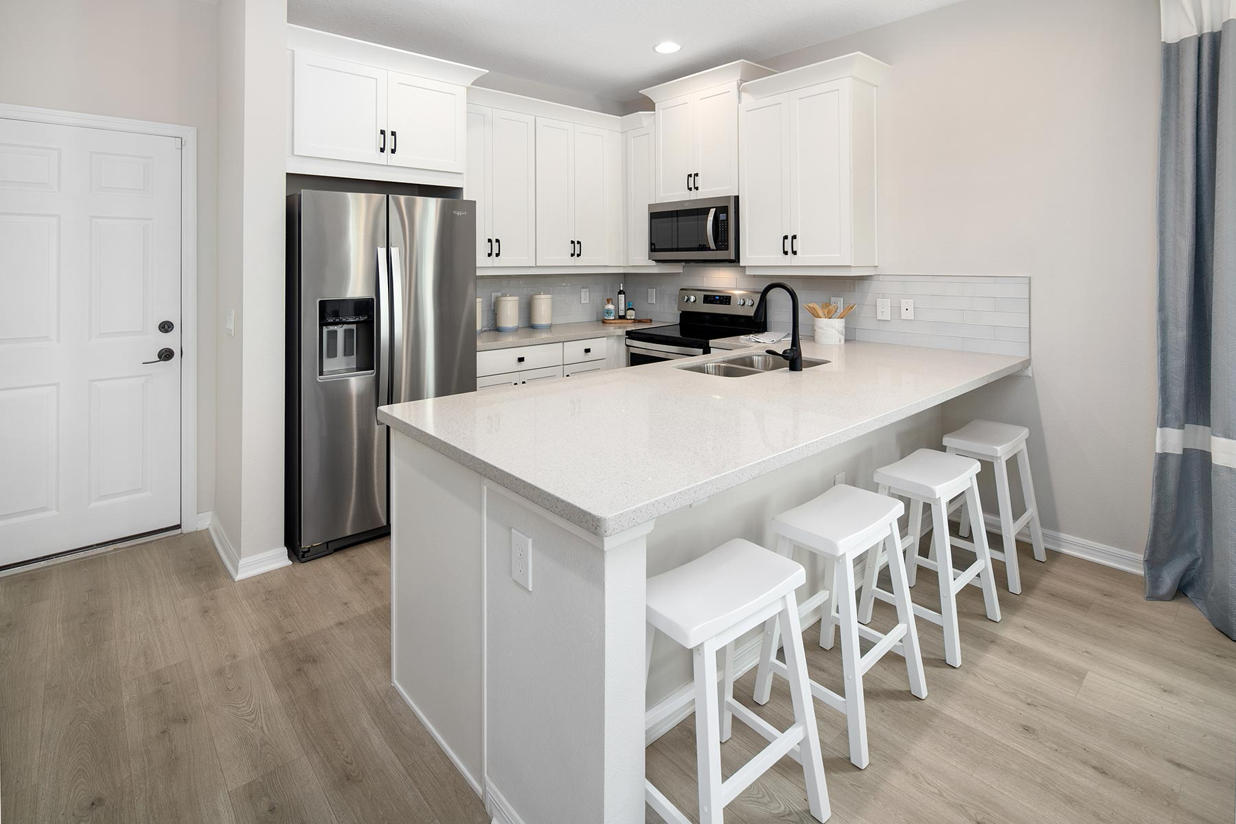 Camilla III Plan Kitchen at Waterbrooke in Clermont Florida by Mattamy Homes