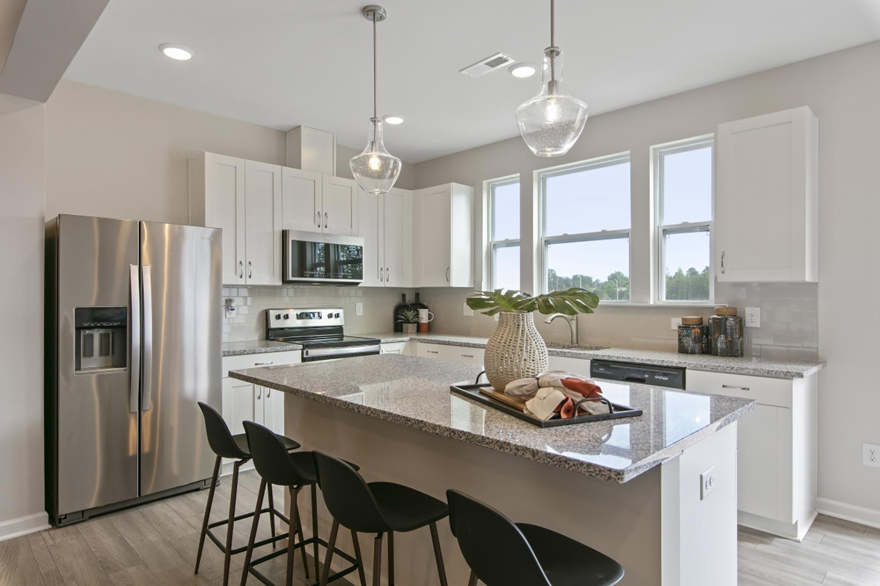 Claymore Plan Kitchen at Minglewood Townhomes in Garner North Carolina by Mattamy Homes