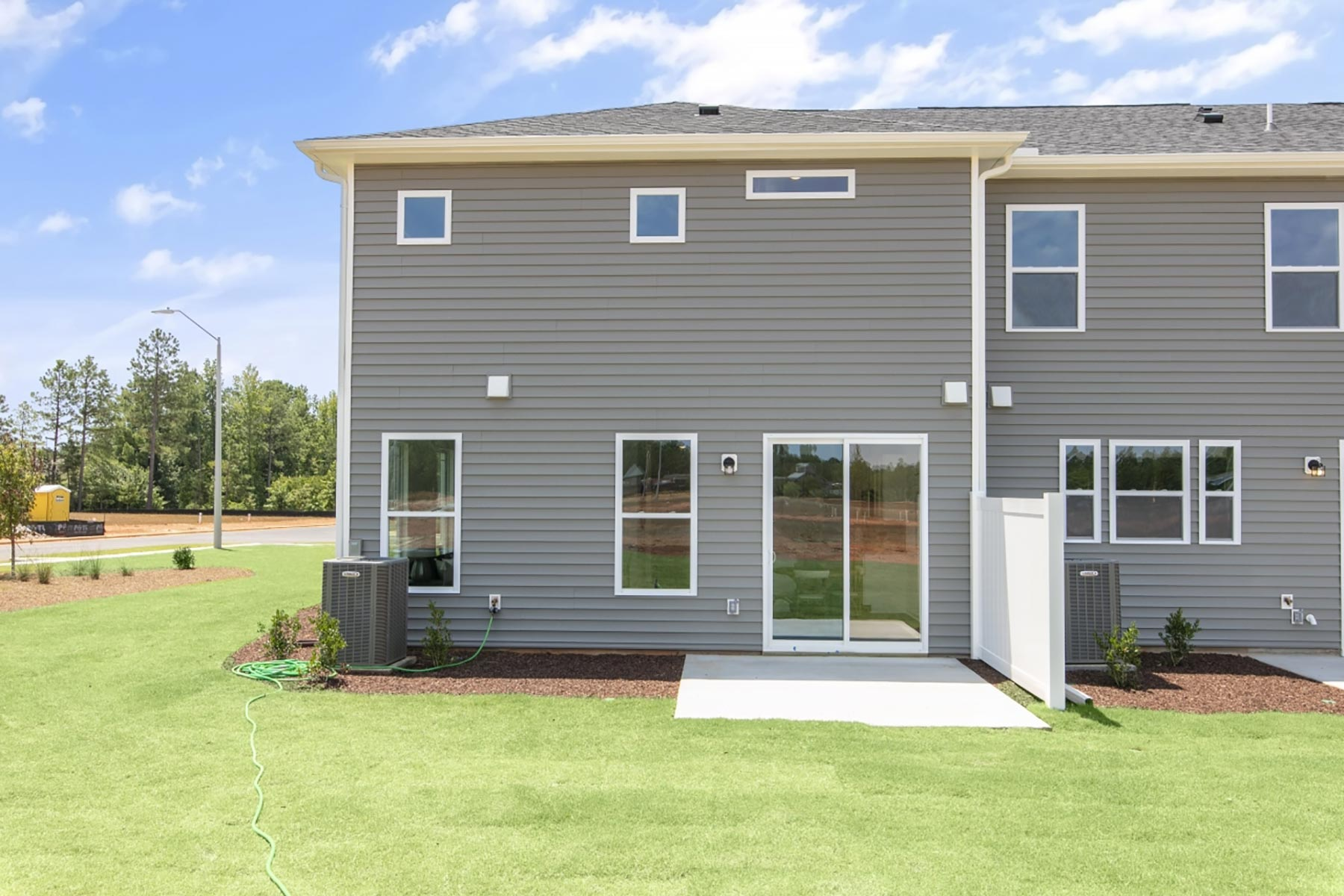 Clifton Plan Elevation Back Side at Minglewood Townhomes in Garner North Carolina by Mattamy Homes