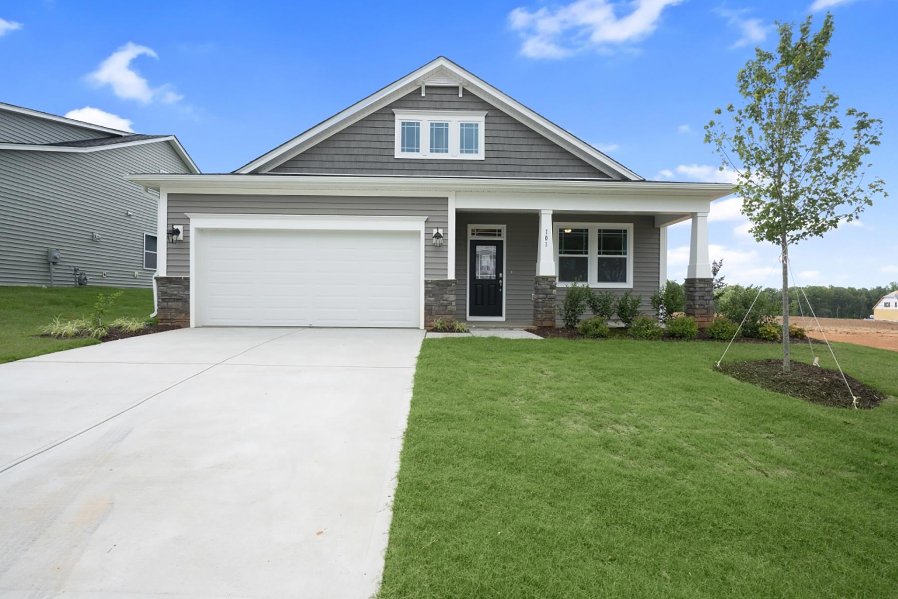 Evelyn Plan rdu-bedford-evelyn-exterior3 at Bedford at Flowers Plantation in Clayton North Carolina by Mattamy Homes