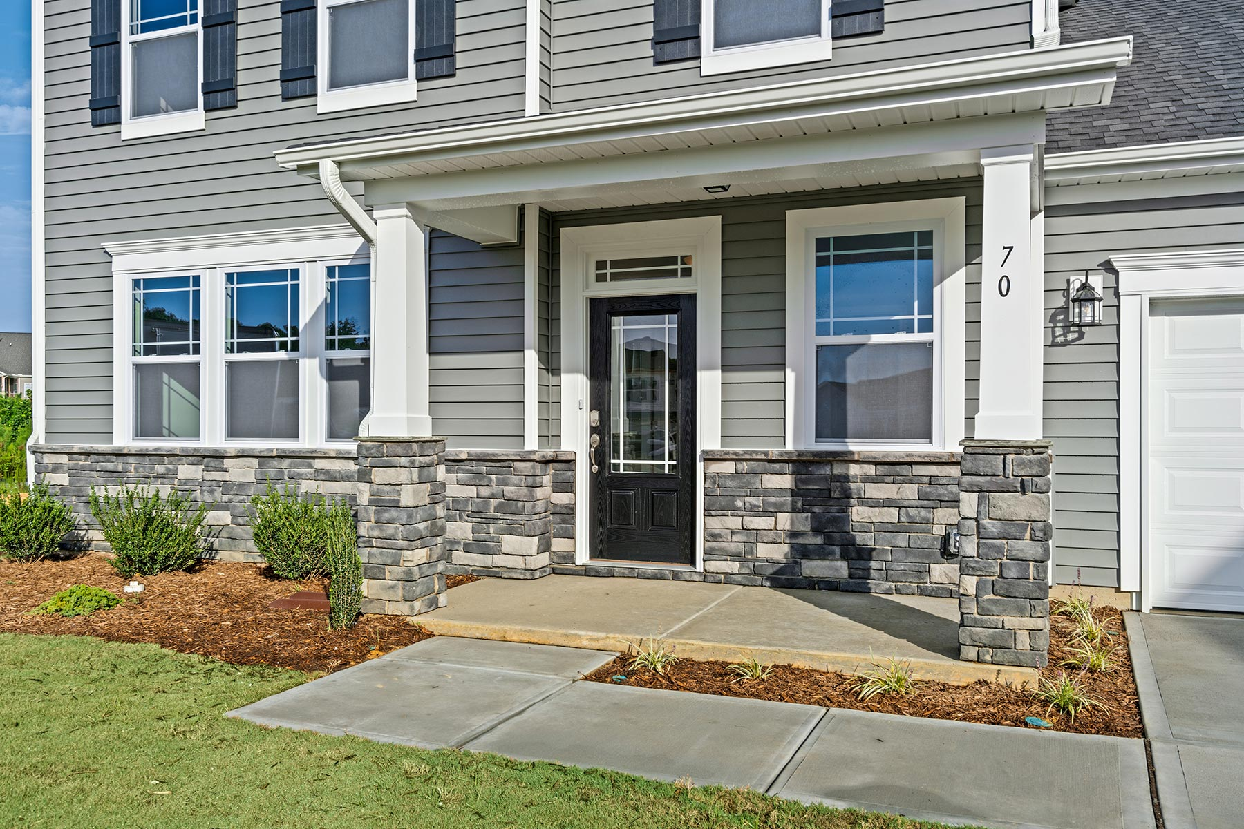 Winston Plan Front Porch at Oak Park in Garner North Carolina by Mattamy Homes